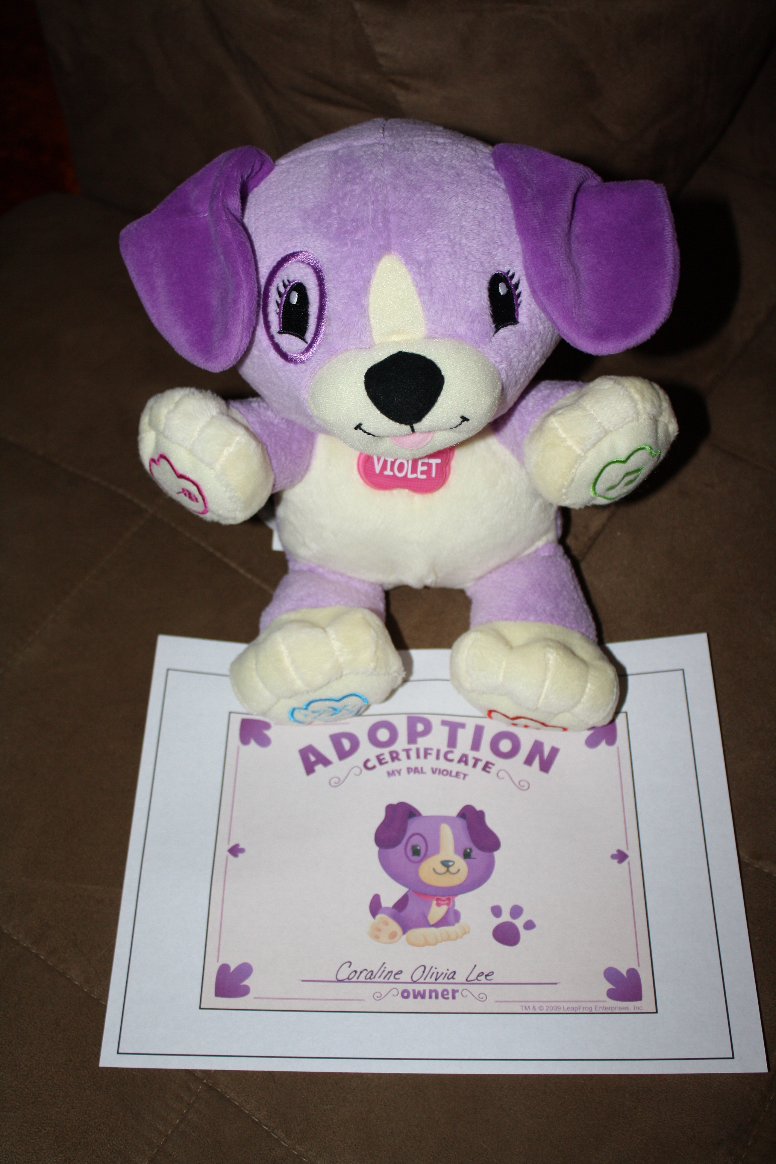 violet with her adoption certificate